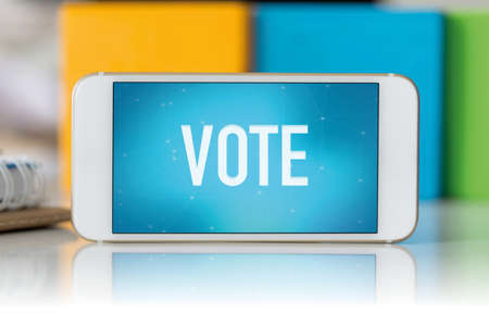 political system: Smart phone which displaying Vote