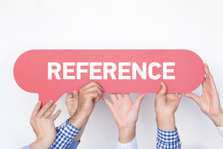 mention: Group of people holding the REFERENCE written speech bubble Stock Photo