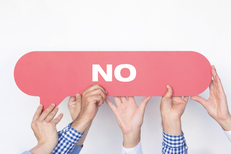 Group of people holding the No written speech bubble