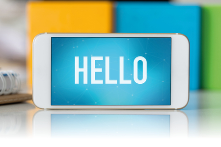 english ethnicity: Smart phone which displaying Hello