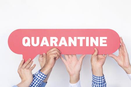 quarantine: Group of people holding the QUARANTINE written speech bubble