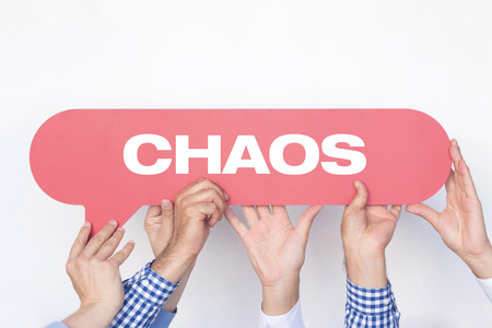 Group of people holding the CHAOS written speech bubble Stock Photo