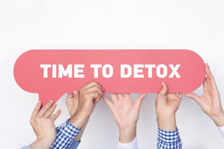 Group of people holding the TIME TO DETOX written speech bubble