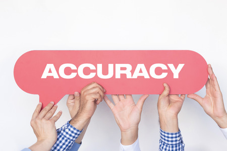 accuracy: Group of people holding the ACCURACY written speech bubble Stock Photo