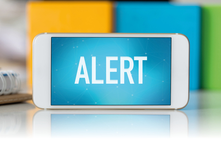 spy ware: Smart phone which displaying Alert Stock Photo
