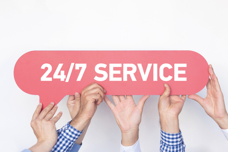 24x7: Group of people holding the 247 SERVICE written speech bubble