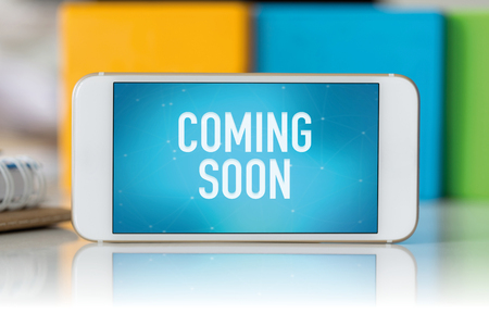 presently: Smart phone which displaying Coming Soon