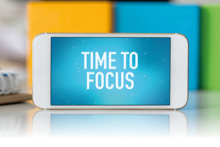distinctness: Smart phone which displaying Time To Focus