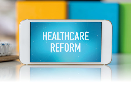 hospital expenses: Smart phone which displaying Healthcare Reform