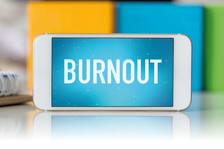 unmotivated: Smart phone which displaying Burnout