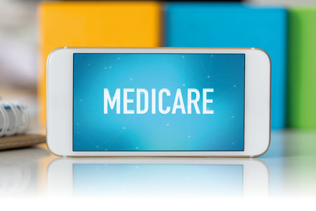 medicare: Smart phone which displaying Medicare Stock Photo