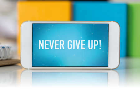 failed attempt: Smart phone which displaying Never Give Up! Stock Photo