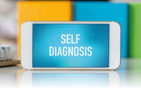 selfcontrol: Smart phone which displaying Self Diagnosis Stock Photo