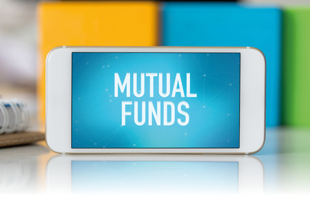 financial diversification: Smart phone which displaying Mutual Funds Stock Photo