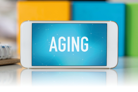 aging: Smart phone which displaying Aging