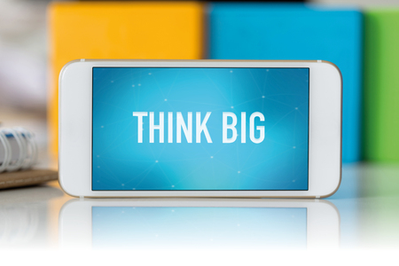 overachieving: Smart phone which displaying Think Big