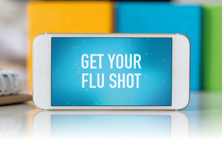 swine flu vaccinations: Smart phone which displaying Get Your Flu Shot Stock Photo