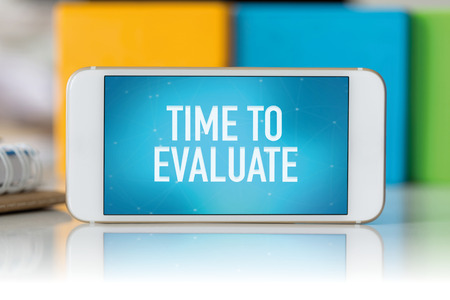 reevaluation: Smart phone which displaying Time To Evaluate Stock Photo