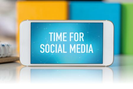 textcloud: Smart phone which displaying Time For Social Media Stock Photo