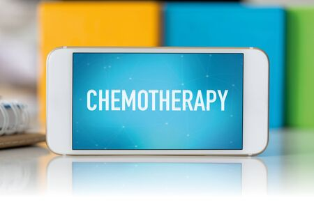 radiotherapy: Smart phone which displaying Chemotherapy Stock Photo