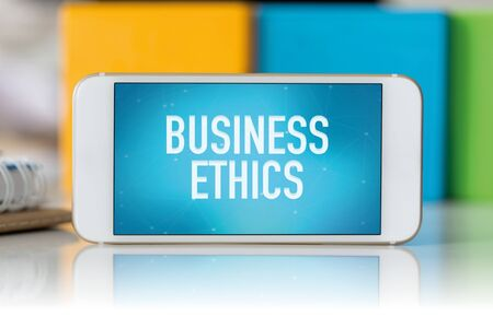 phone business: Smart phone which displaying Business Ethics Stock Photo