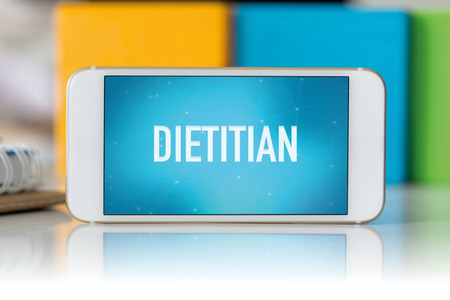 dietology: Smart phone which displaying Dietitian Stock Photo