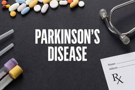 parkinson's disease: PARKINSONS DISEASE written on black background with medication
