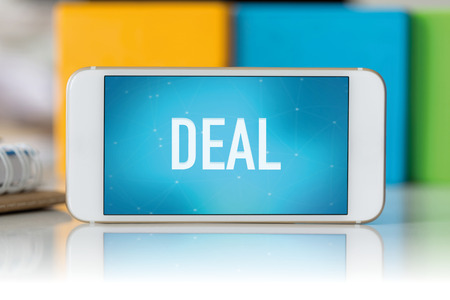 businessmeeting: Smart phone which displaying Deal Stock Photo