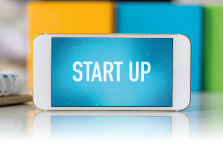 businessteamwork: Smart phone which displaying Start Up