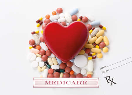 MEDICARE written on heart and medication background