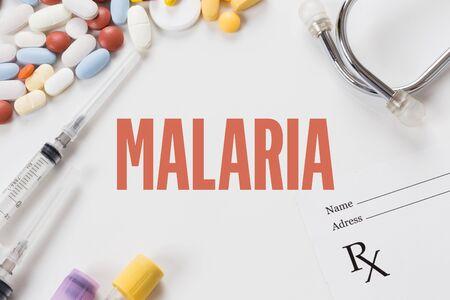 malaria: MALARIA written on white background with medication