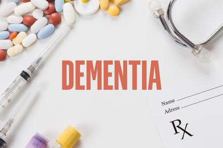 DEMENTIA written on white background with medication Stock Photo