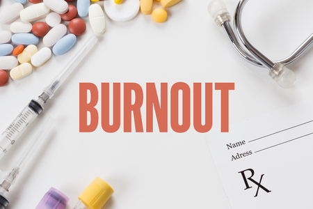 burnout: BURNOUT written on white background with medication Stock Photo