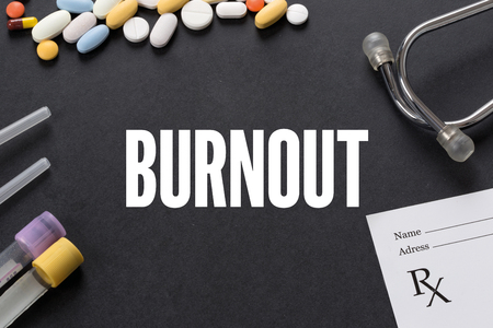 burnout: BURNOUT written on black background with medication Stock Photo