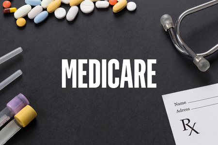 MEDICARE written on black background with medication