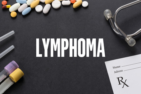 lymphoma: LYMPHOMA written on black background with medication Stock Photo