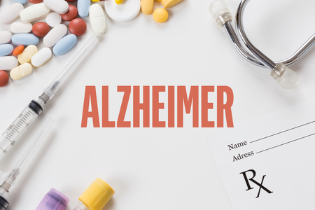 ALZHEIMER written on white background with medication