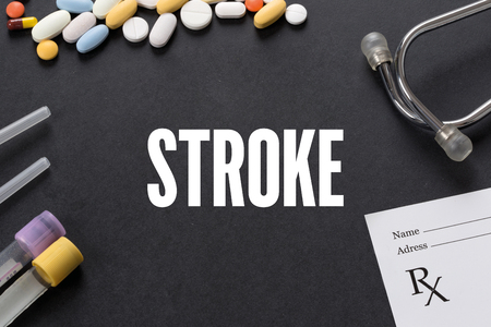 medicaid: STROKE written on black background with medication Stock Photo