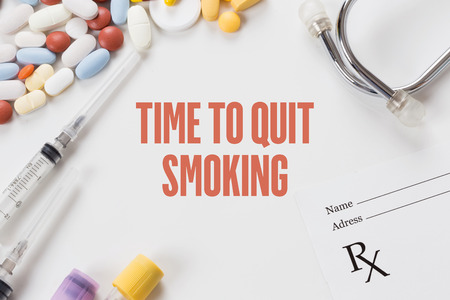 TIME TO QUIT SMOKING written on white background with medication