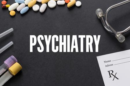 psychiatry: PSYCHIATRY written on black background with medication