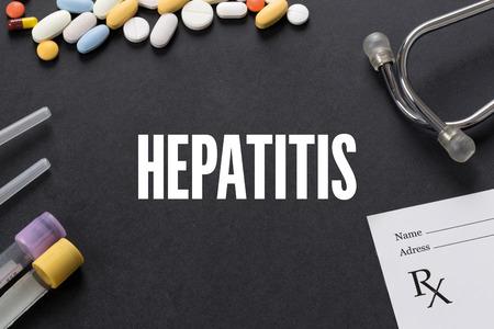 hepatitis: HEPATITIS written on black background with medication