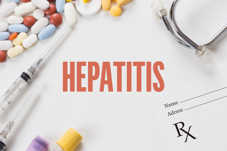 HEPATITIS written on white background with medication