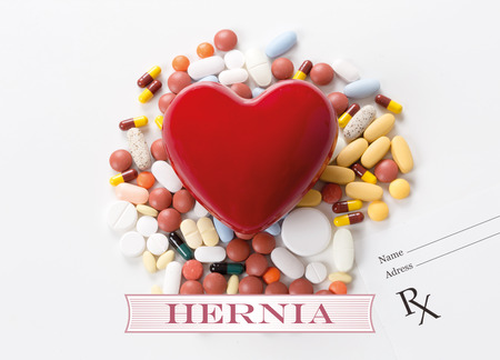 hernia: HERNIA written on heart and medication background