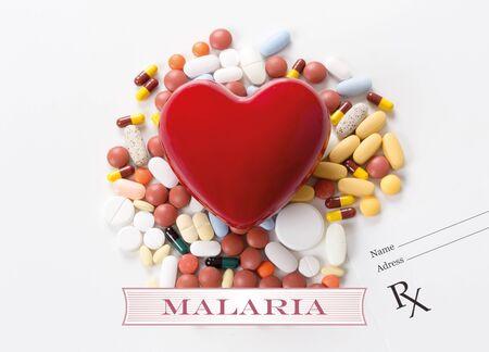 malaria: MALARIA written on heart and medication background