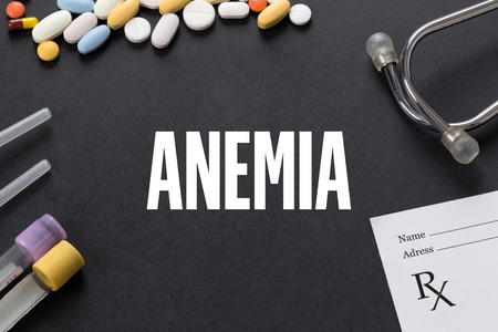 anemia: ANEMIA written on black background with medication