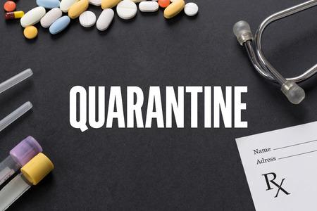 quarantine: QUARANTINE written on black background with medication Stock Photo