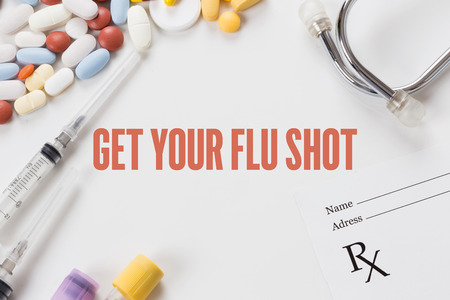 swine flu vaccination: GET YOUR FLU SHOT written on white background with medication