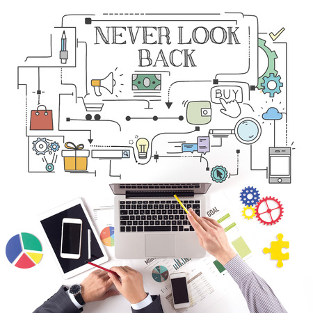 forthcoming: PEOPLE WORKING WORKPLACE TECHNOLOGY TEAMWORK NEVER LOOK BACK CONCEPT Stock Photo