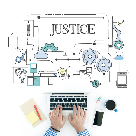 justness: Man using laptop on workplace and JUSTICE concept