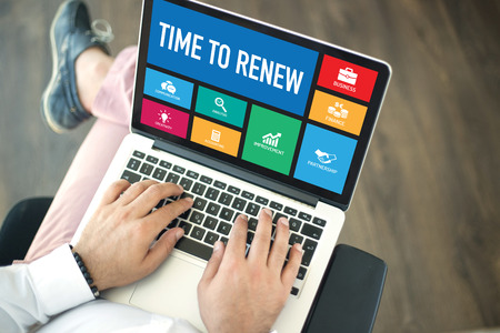 renew: People using laptop in an office and TIME TO RENEW concept on screen